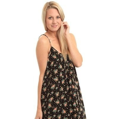 Woman wearing a dark floral dress