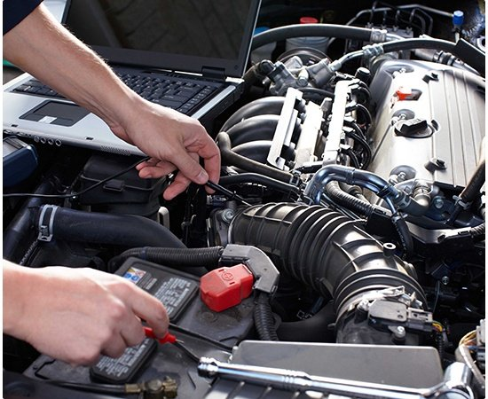 Automotive technician performing diagnostic