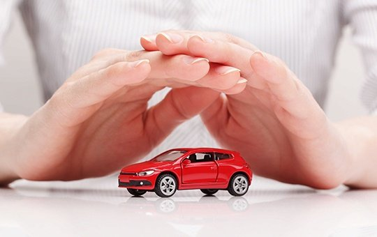 Hands over a car model