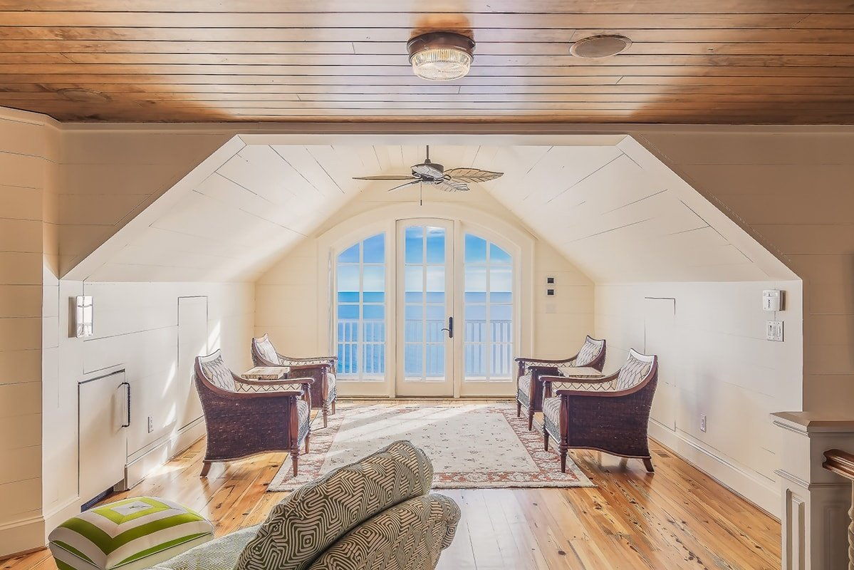 Attic with armchairs on a wooden floor