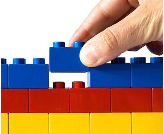 Person playing with lego bricks
