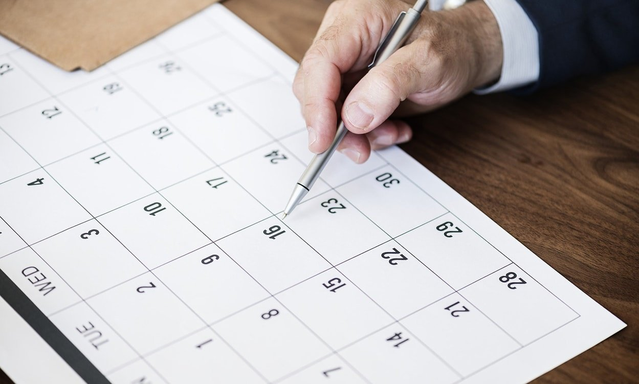 Businessman scheduling appointments in a calendar