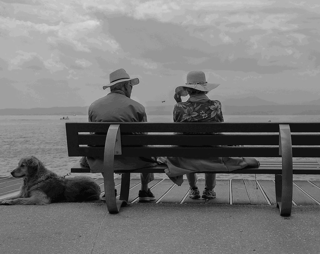 Elderly couple sitting near the sea