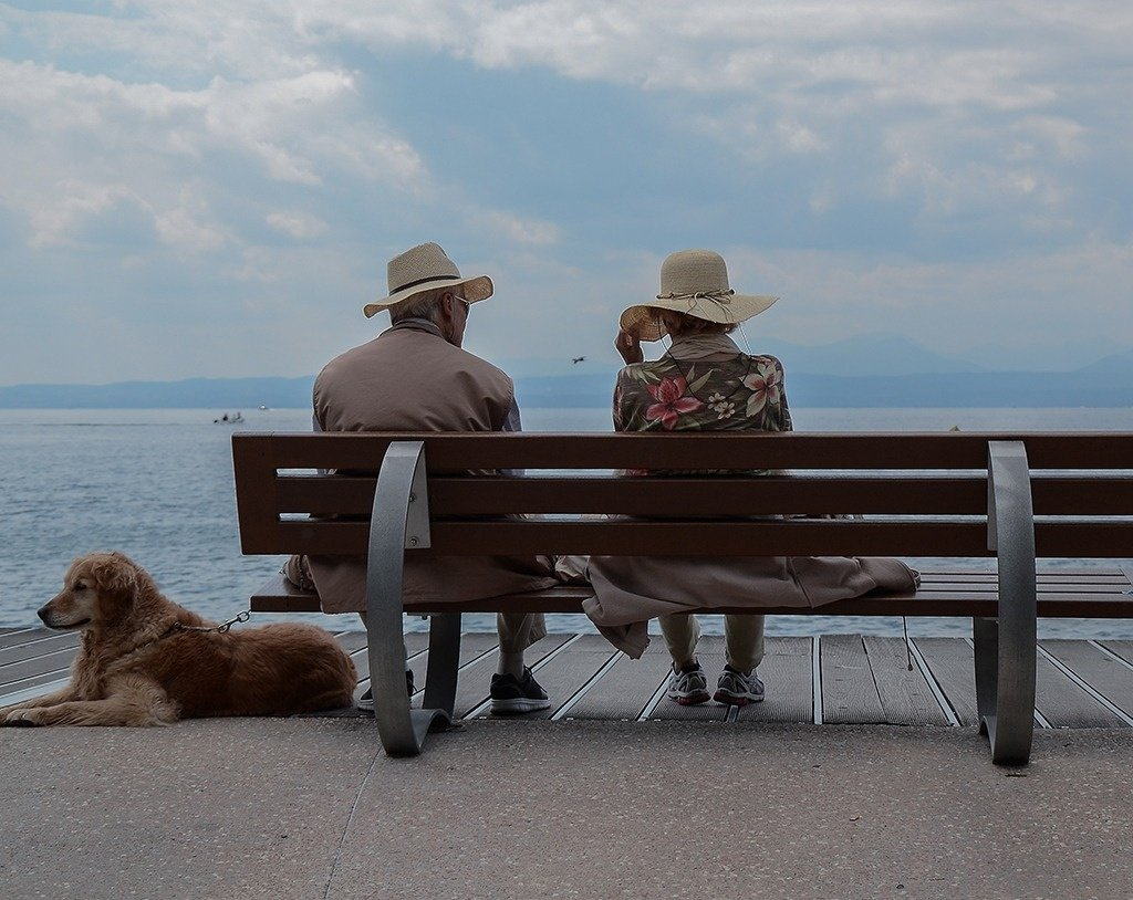 Elderly couple sitting near the sea