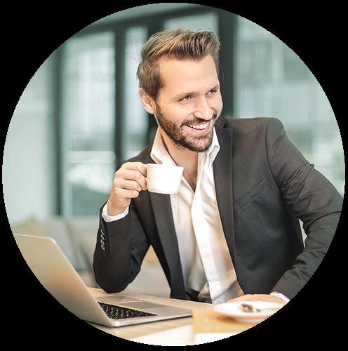 Smiling businessman drinking coffee