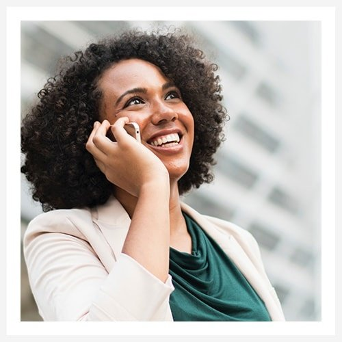 Smiling businesswoman talking on a mobile phone