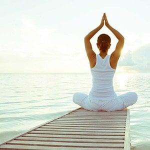 Woman practising yoga outside