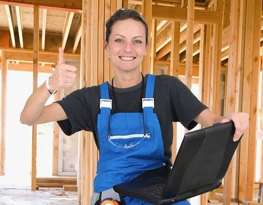 Woman in working clothes giving the thumbs up