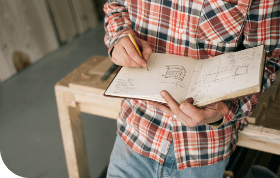Person sketching in a notebook