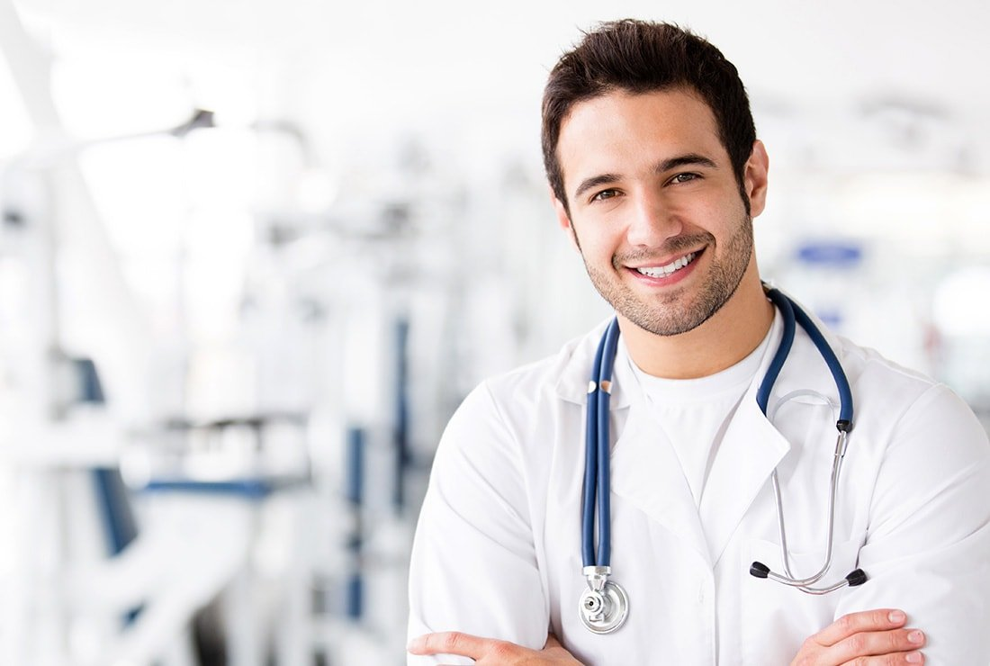 Young male doctor smiling