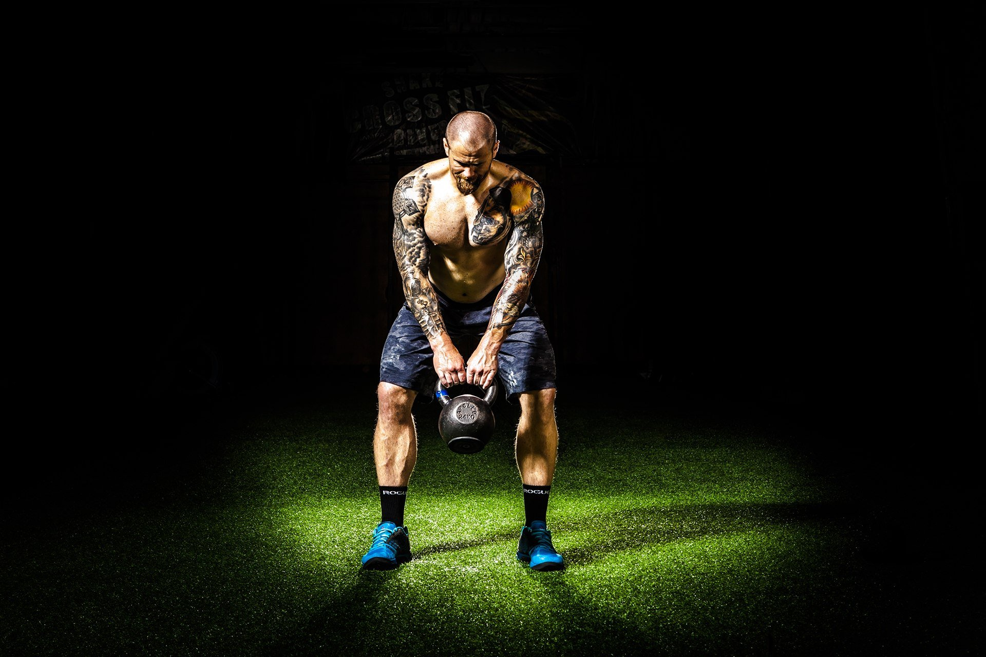 Man doing an exercise with a kettlebell
