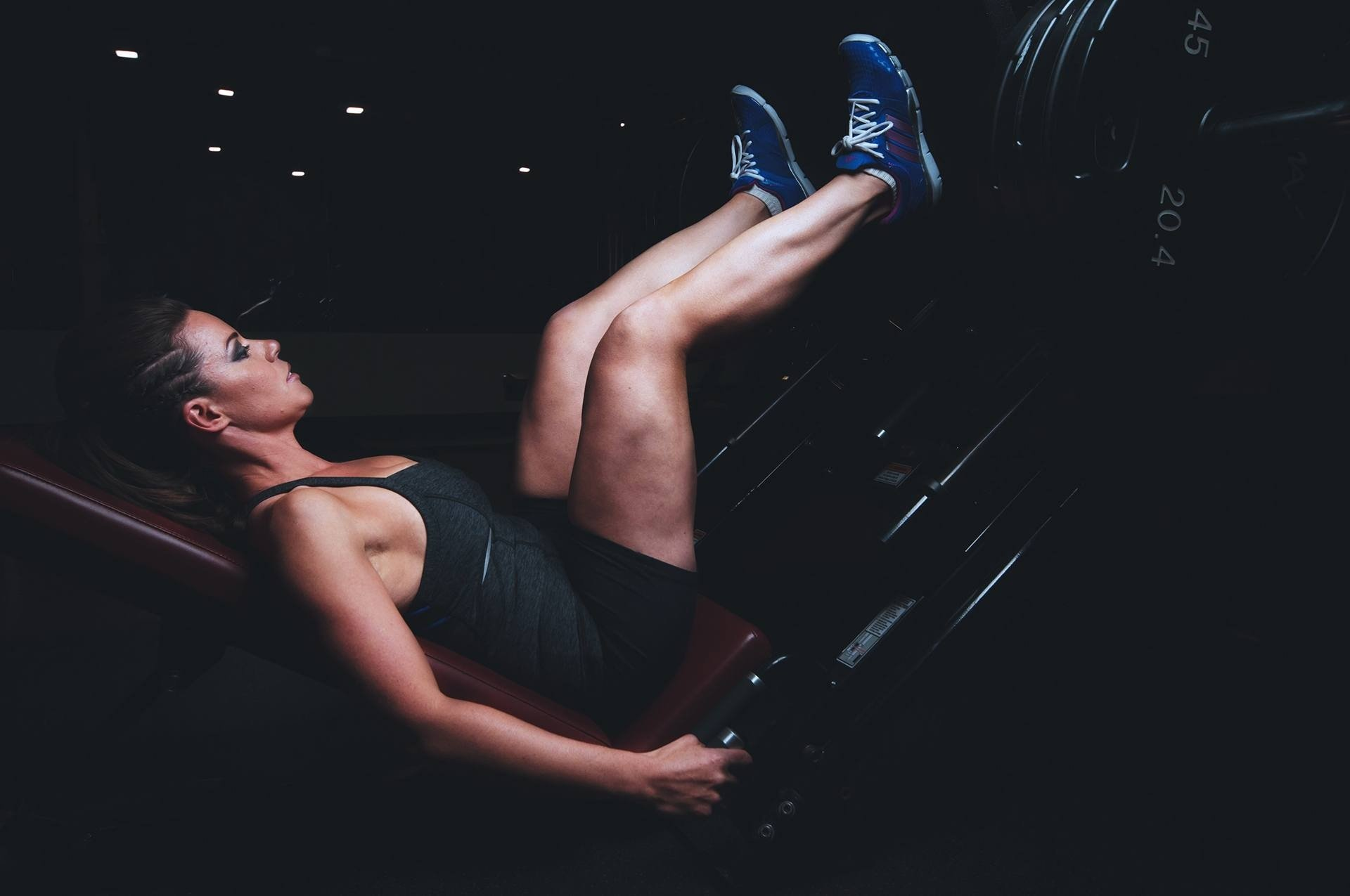 Woman doing a seated leg press
