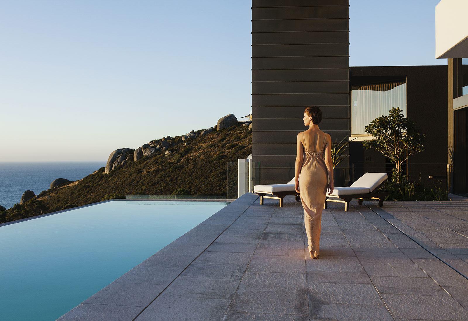 Elegant woman walking near a pool
