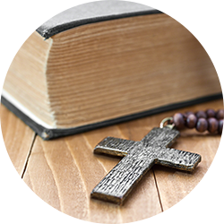 Wooden cross next to the bible