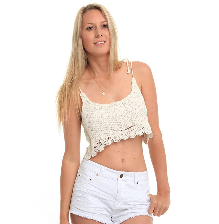 Blond woman wearing white shorts and a vest