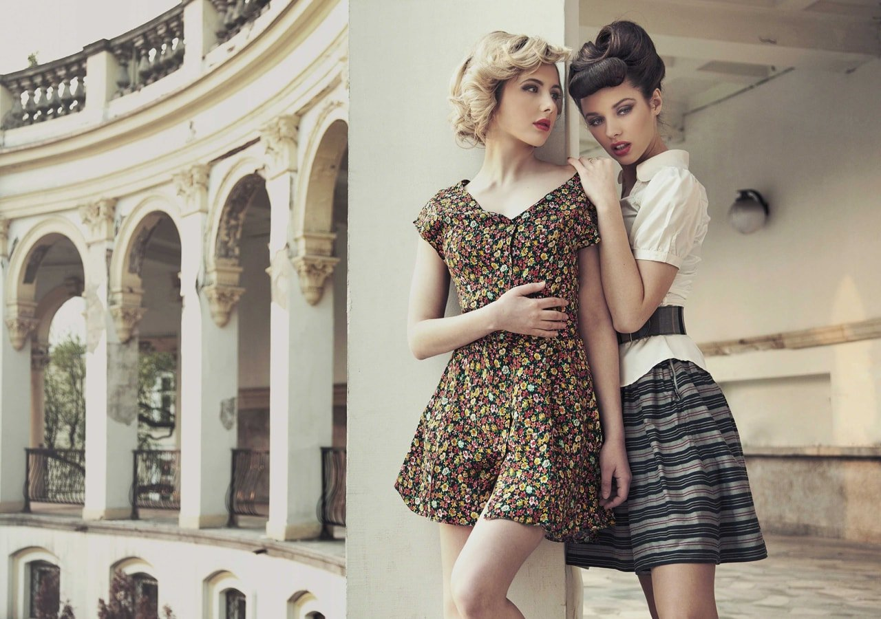 Two young women posing for a fashion photoshoot