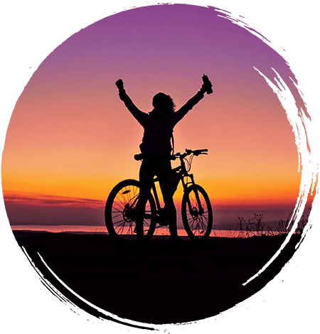 Silhouette of a happy person on a bike