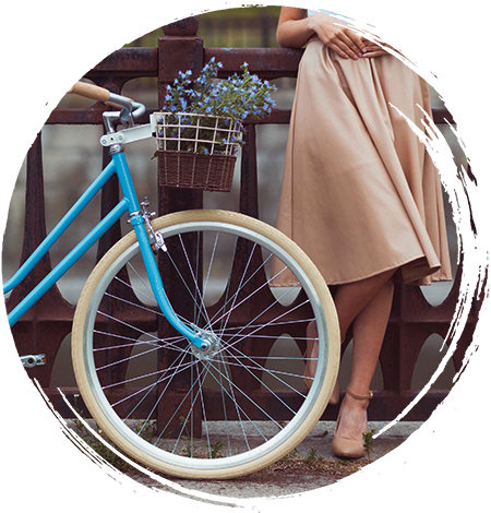 Woman in a dress next to a bike