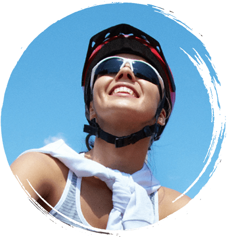 Smiling person wearing a bike helmet and glasses