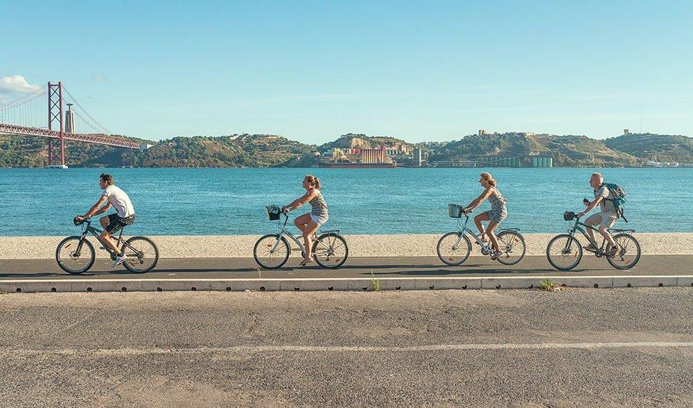 People riding bikes along a promenade